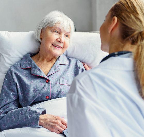 senior woman facing to her caregiver