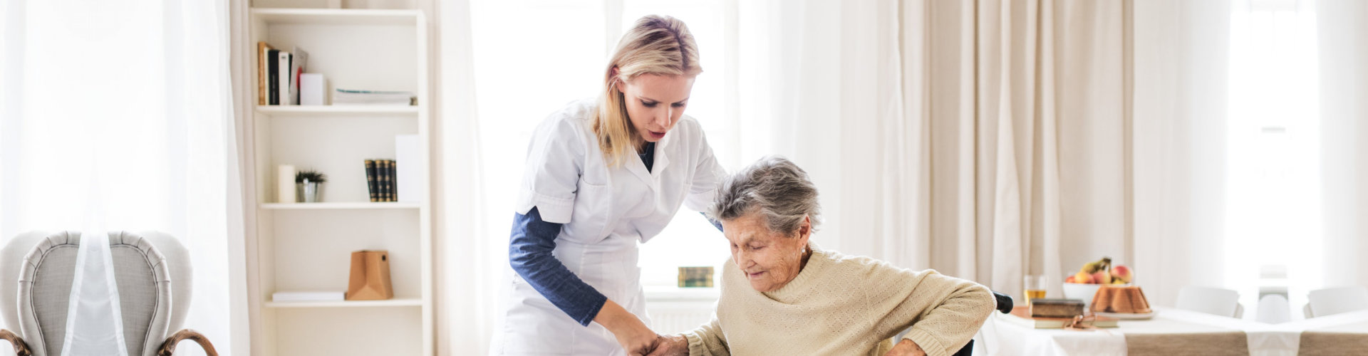 caregiver assisting the old lady