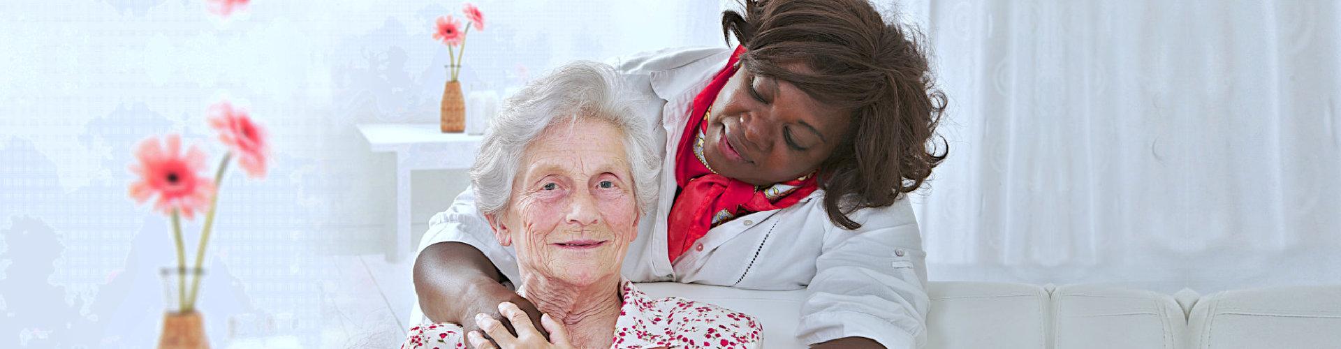 senior woman smiling while her caregiver watching